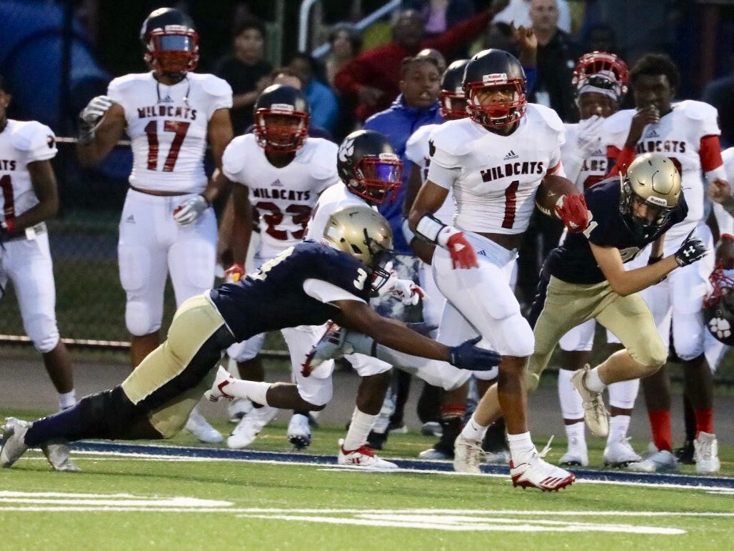Wilson's Desi Floyd Jr. runs down the sideline to score on his team's first possession.