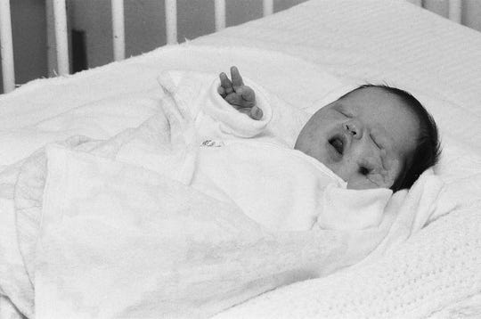 A baby girl was found abandoned at the bottom of a woman's apartment stairs on Highland Avenue and Lilac Drive July 25, 1978.  This is the baby at a local hospital Wednesday, July 26, 1978.  Social services department at the time named her Heather Ann.