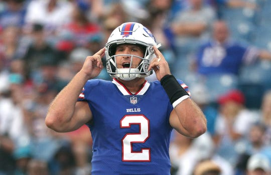 """Bills quarterback Nathan Peterman makes a call at the line of scrimmage against Carolina. """"I think every time I've gotten on the field, it's a new opportunity and that you're not tied to your past failures,'' Peterman said."""