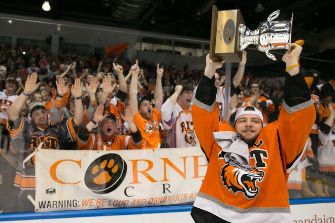 RIT forward Andrew Miller celebrates after RIT defeated Robert Morris University to win the Atlantic Hockey final and earn a spot in the NCAA Tournament in 2016. RIT drew average of 3,211 fans to its five conference title games held in Rochester. The conference is moving its Frozen Four weekend to Buffalo after 12 years at Blue Cross Arena.