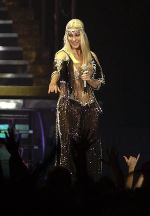 Cher acknowledges the crowd at Blue Cross Arena during the opening number of her 2003 concert.