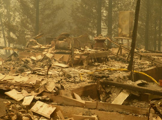 A Pollard Flat home is left in ruins after it was destroyed in the Delta Fire.