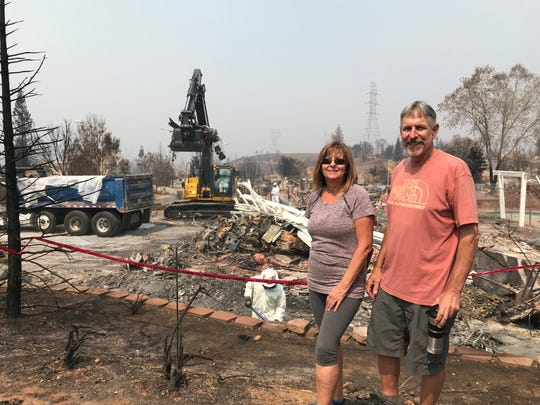 Maureen and Dan Kissick plan to rebuild on the site where their home once stood. As part of a lengthy process that started Sept. 6, CalRecycle workers must first remove tons of debris from hundreds of properties in Redding and Shasta County.