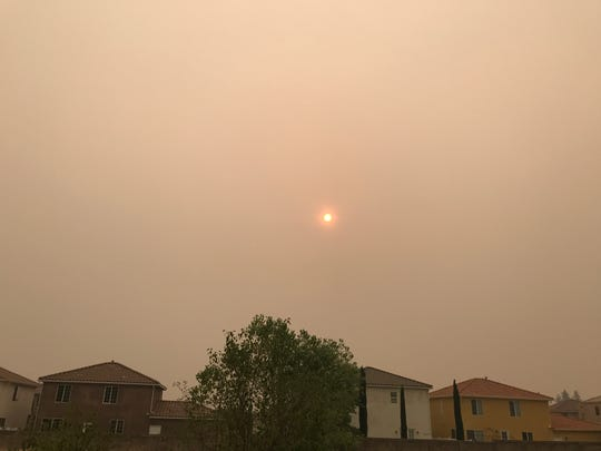 The sun is shrouded in smoke on Friday morning, Sept. 7, 2018 in Redding from the Delta, Hirz and Kerlin fires burning in the Shasta-Trinity National Forest.