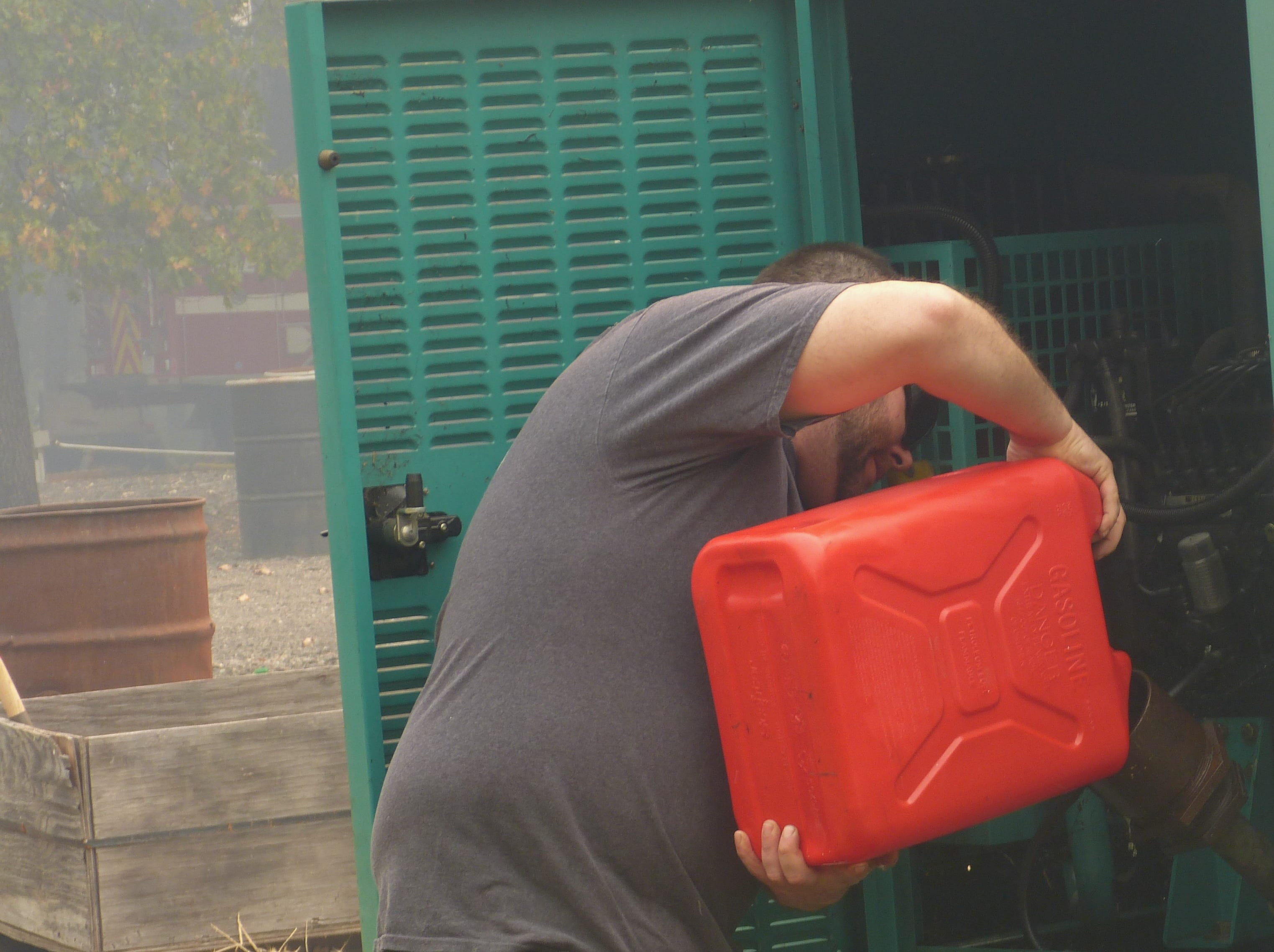 Daniel Harsh, owner of Pollard Flat Food and Fuel, adds gas Friday to the generator at his evacuated business.