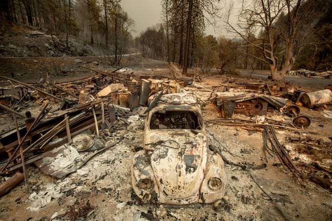 A scorched VW Beetle rests in a clearing after the Delta Fire burned through the Lamoine community in the Shasta-Trinity National Forest, Calif., on Thursday, Sept. 6, 2018.