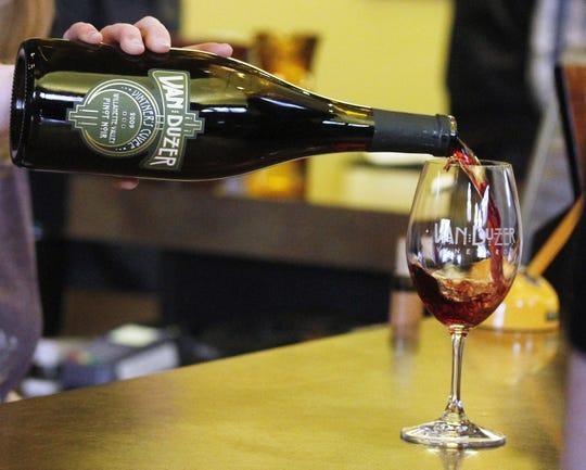 Danielle Blanchette pours wine at Van Duzer Vineyards on Friday, Nov. 25, 2011.