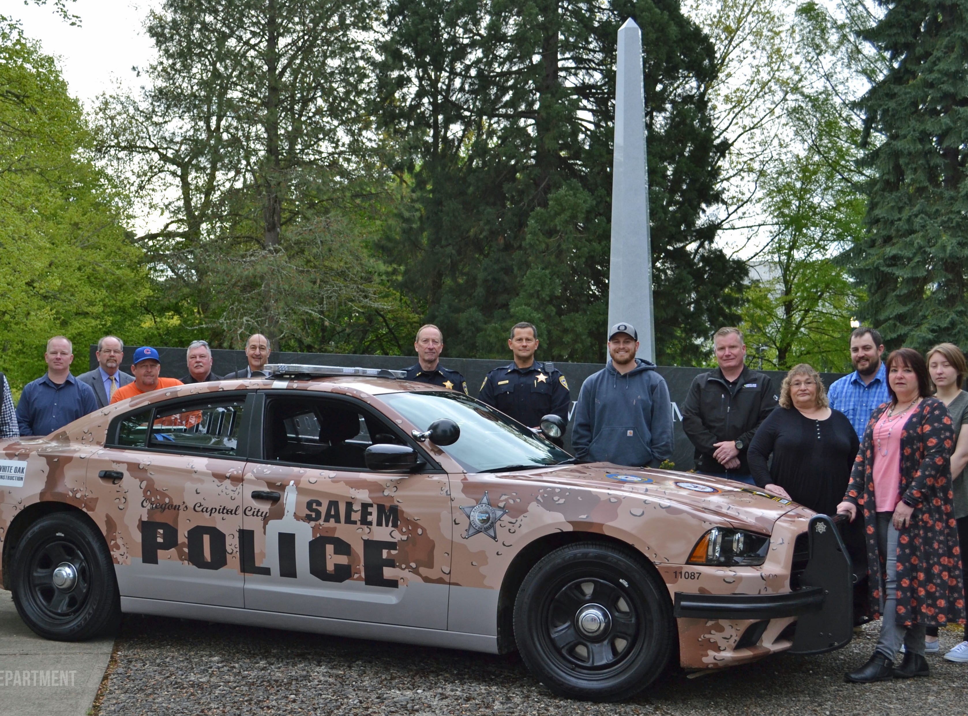 A police cruiser sported a camo wrap for National Military Appreciation Month during May of 2017.