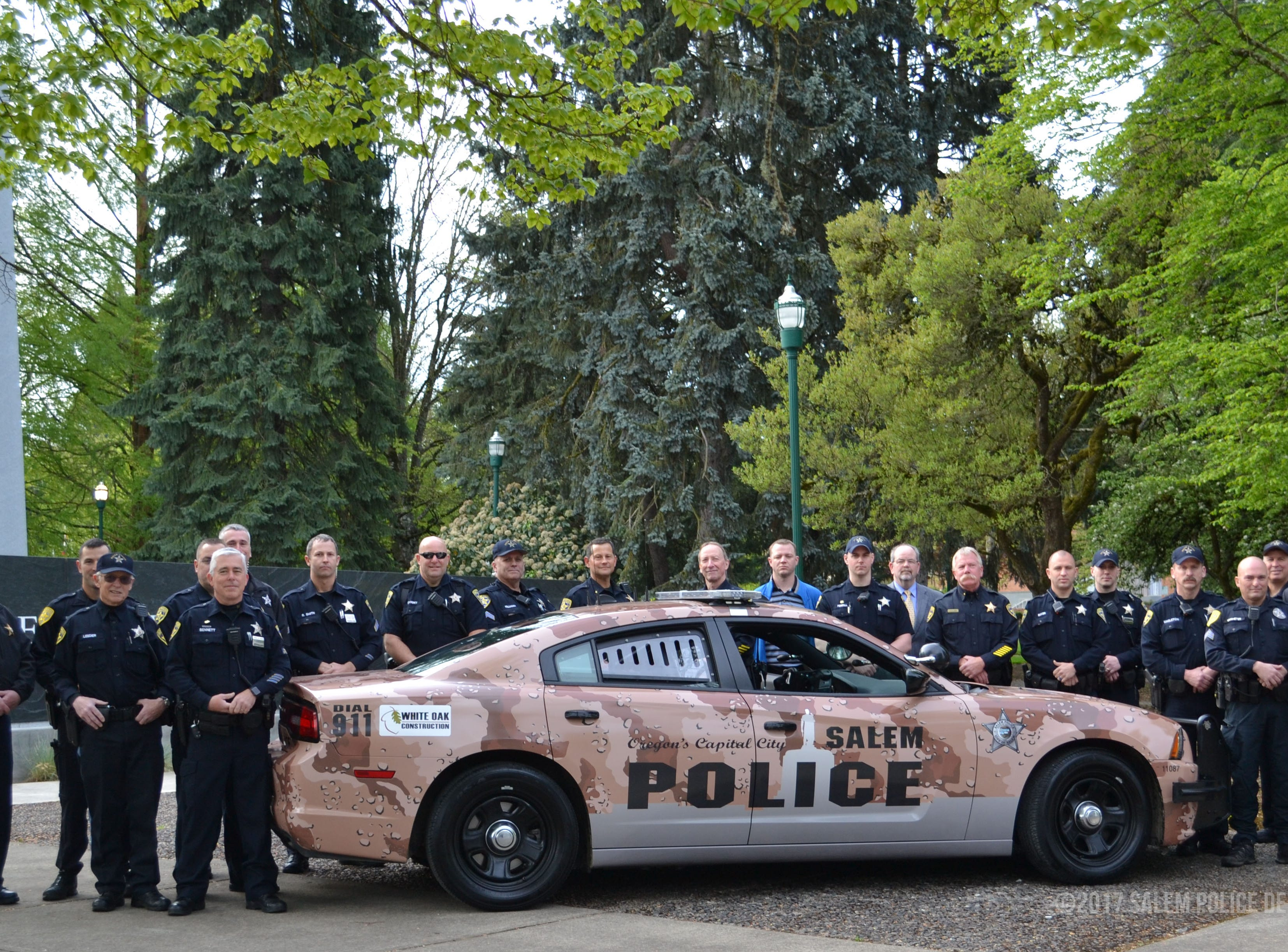 Veterans with the Salem Police Department stand with a specially wrapped cruiser for National Military Appreciation Month in May of 2017.