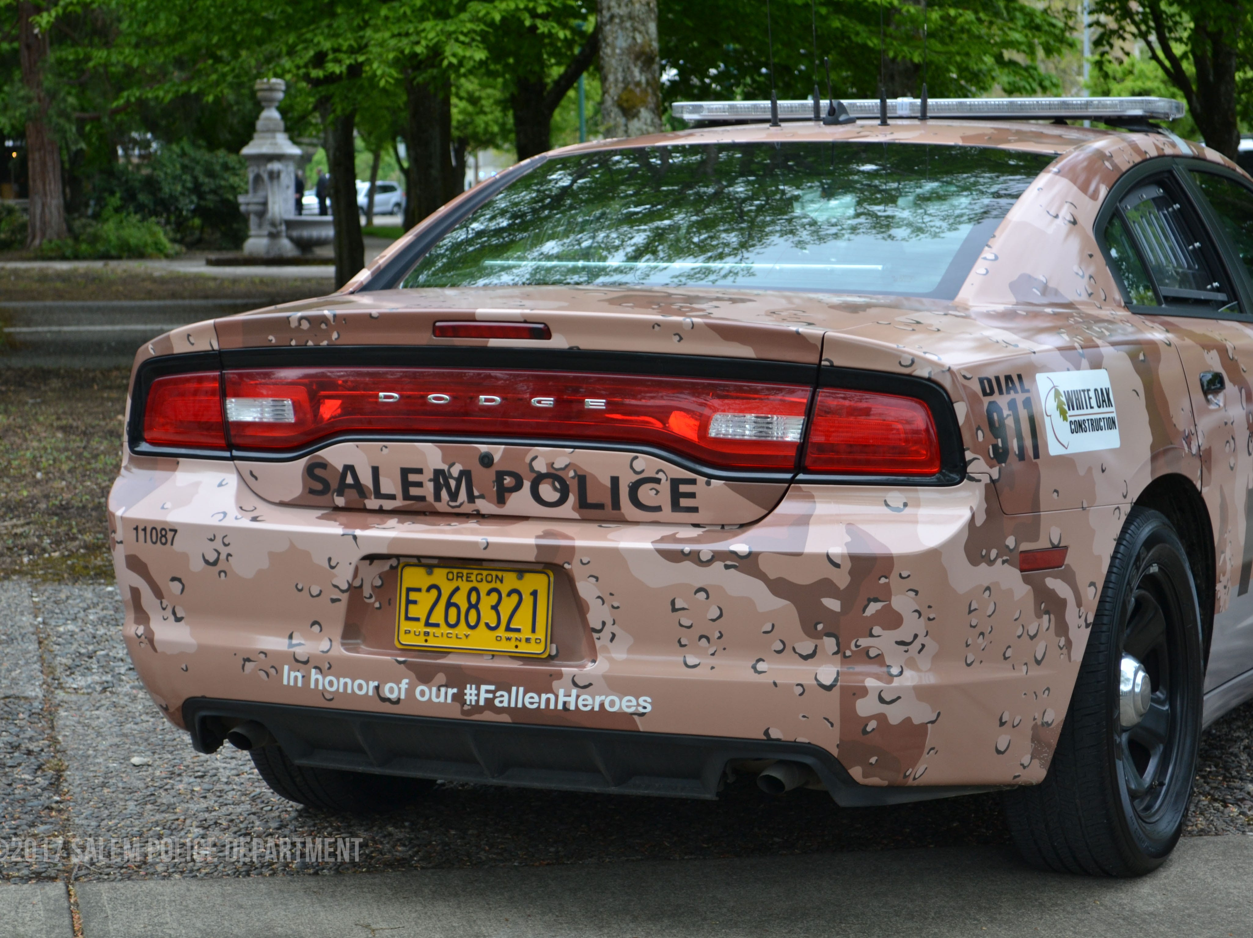A custom camouflage wrap on a Salem Police Department for National Military Appreciation Month in May of 2017.