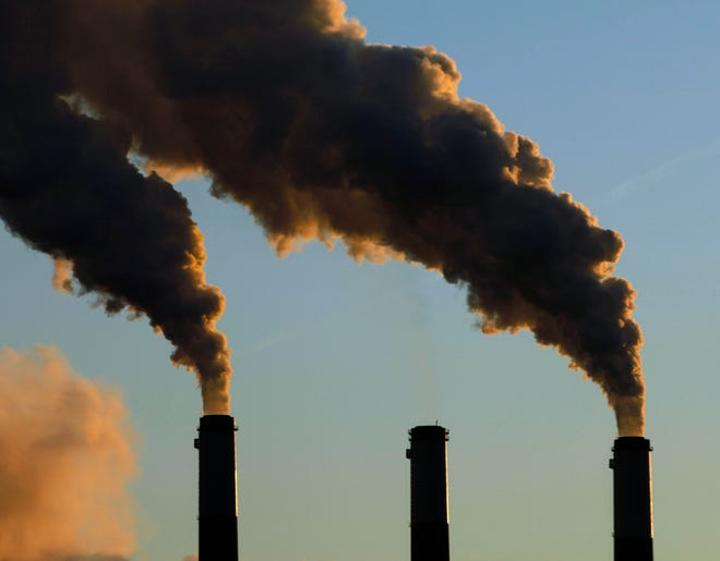 Smokestack emissions are seen coming from a coal-burning power plant.