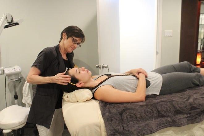 Jody White performs skincare treatment on patient Jamie Meeks at  Jody Aesthetics, 2102 Pecos St., suite 12.