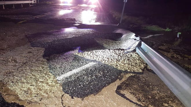 A section of roadway has broken up due to heavy flooding on Farm-to-Market Road 915 between Eldorado and Mertzon the night of Thursday, Sept. 6, 2016. Forecasters have issued a flash flood watch for the area through late Friday night.