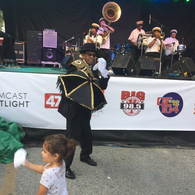 A child dances in front of the Treme Brass Band at the City Stage at the National Folk Festival in Salisbury, Maryland on Friday, Sept. 7, 2018.