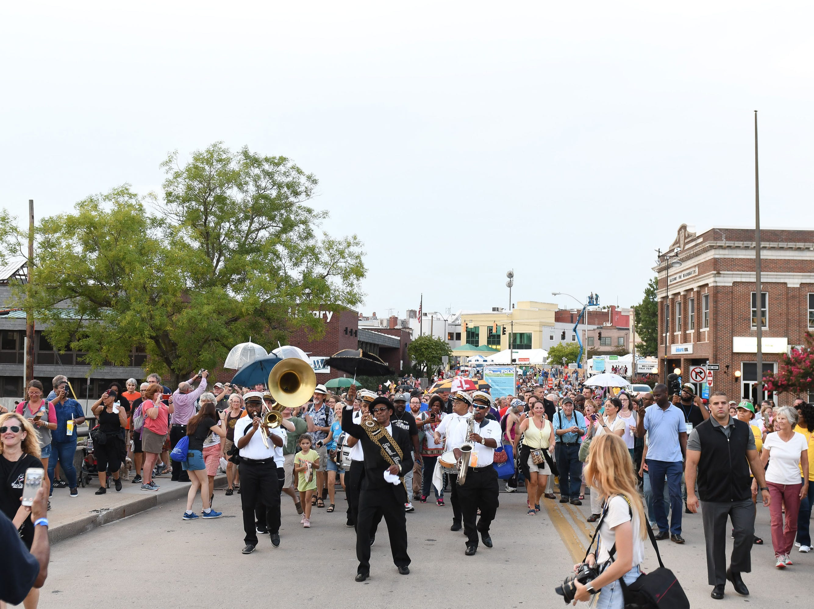 The Treme Brass Band paraded down South Division Street during the 78th National Folk Festival in Salisbury, Md. on Friday, Sept 7, 2018.
