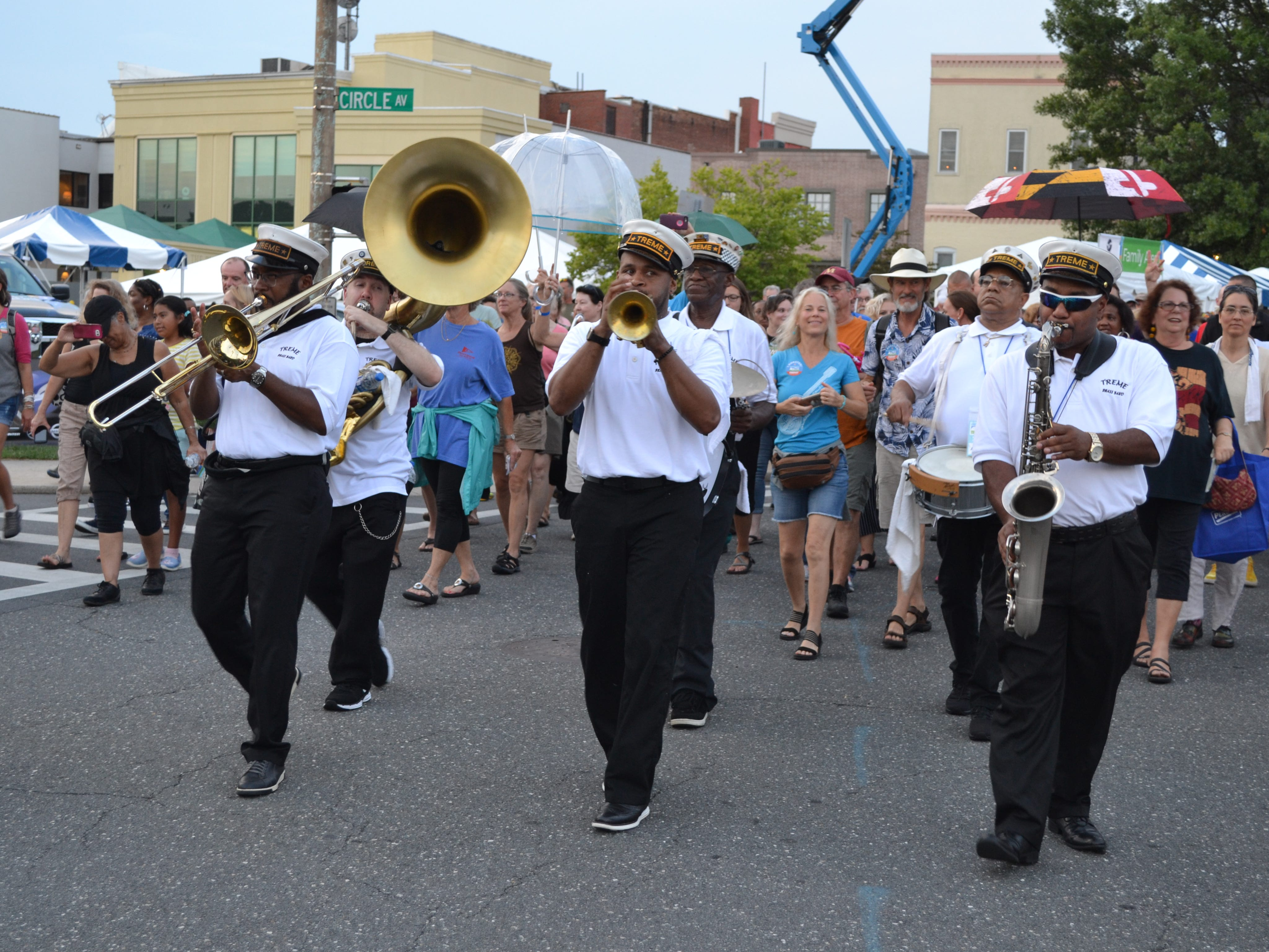 The Treme Brass Band parades down Division Street at the National Folk Festival in Salisbury on Friday night.