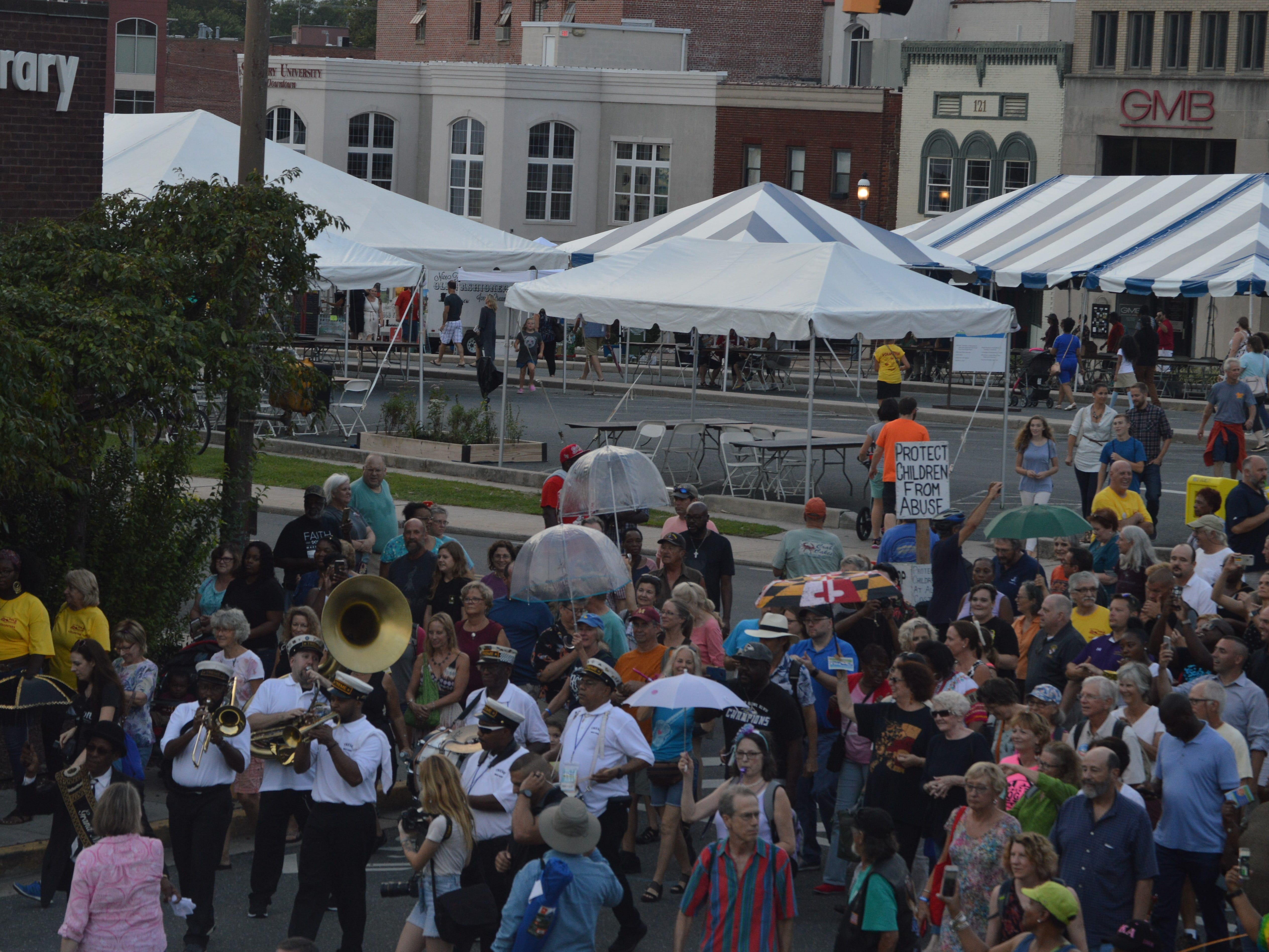 The Treme Brass Band leads a parade through downtown Salisbury during the National Folk Festival on Sept. 7, 2018.