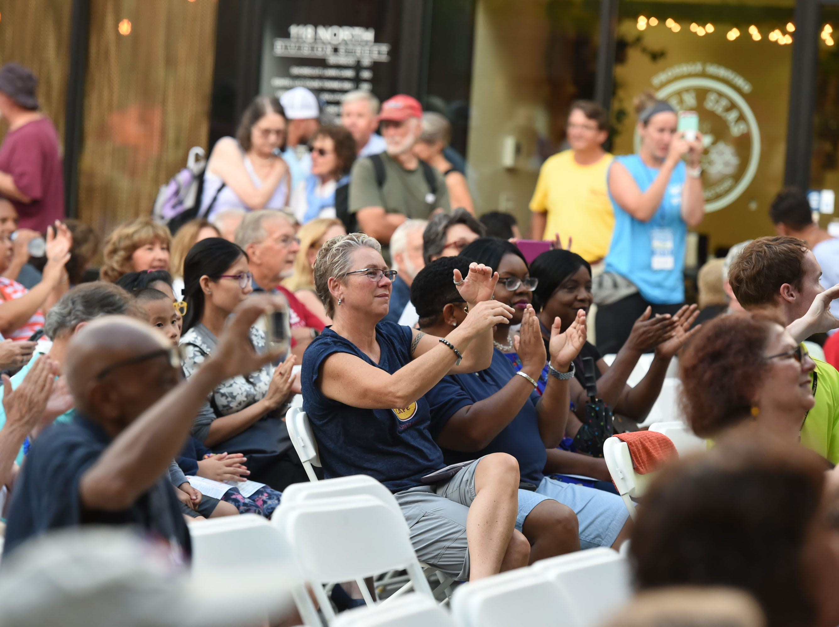 The crowd gets into the music during the kick off of the 78th National Folk Festival on Friday, Sept. 7, 2018.