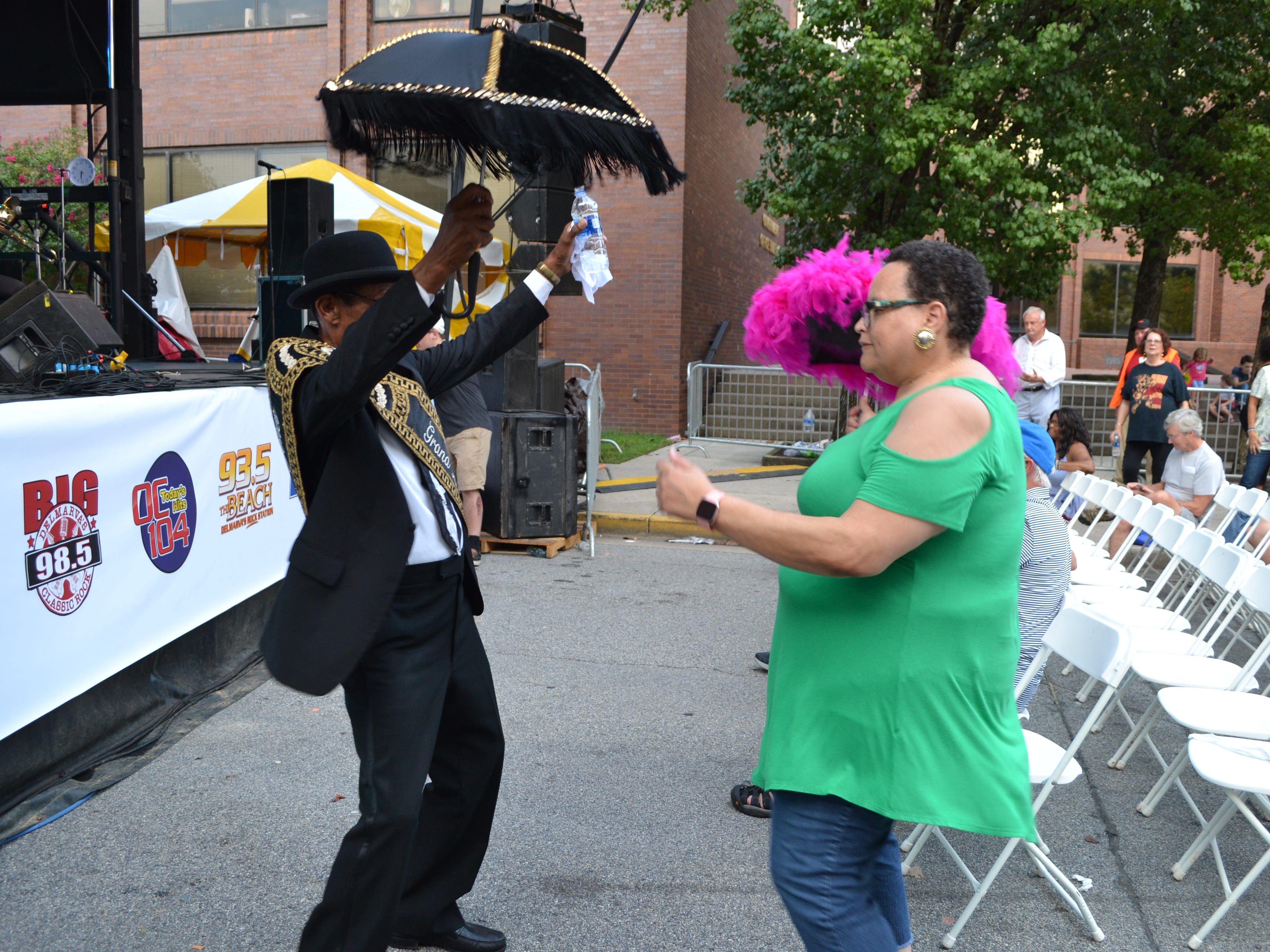 Adrienne Webber of Fruitland dances with Oswald Jones, the grand marshal of the Treme Brass Band, at the National Folk Festival in Salisbury on Friday night.