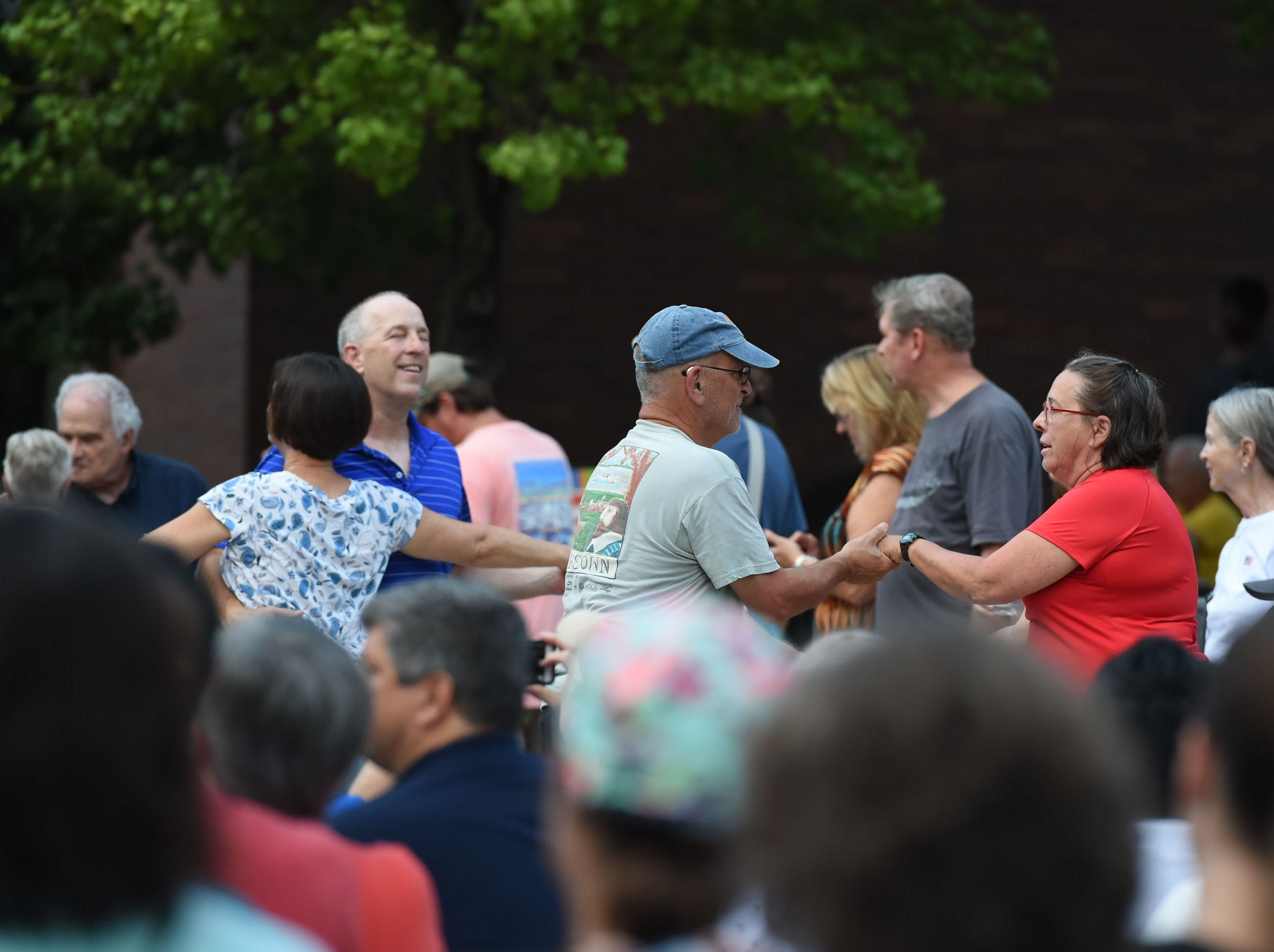 Couples dance in the streets during the kick off of the 78th National Folk Festival on Friday, Sept. 7, 2018.