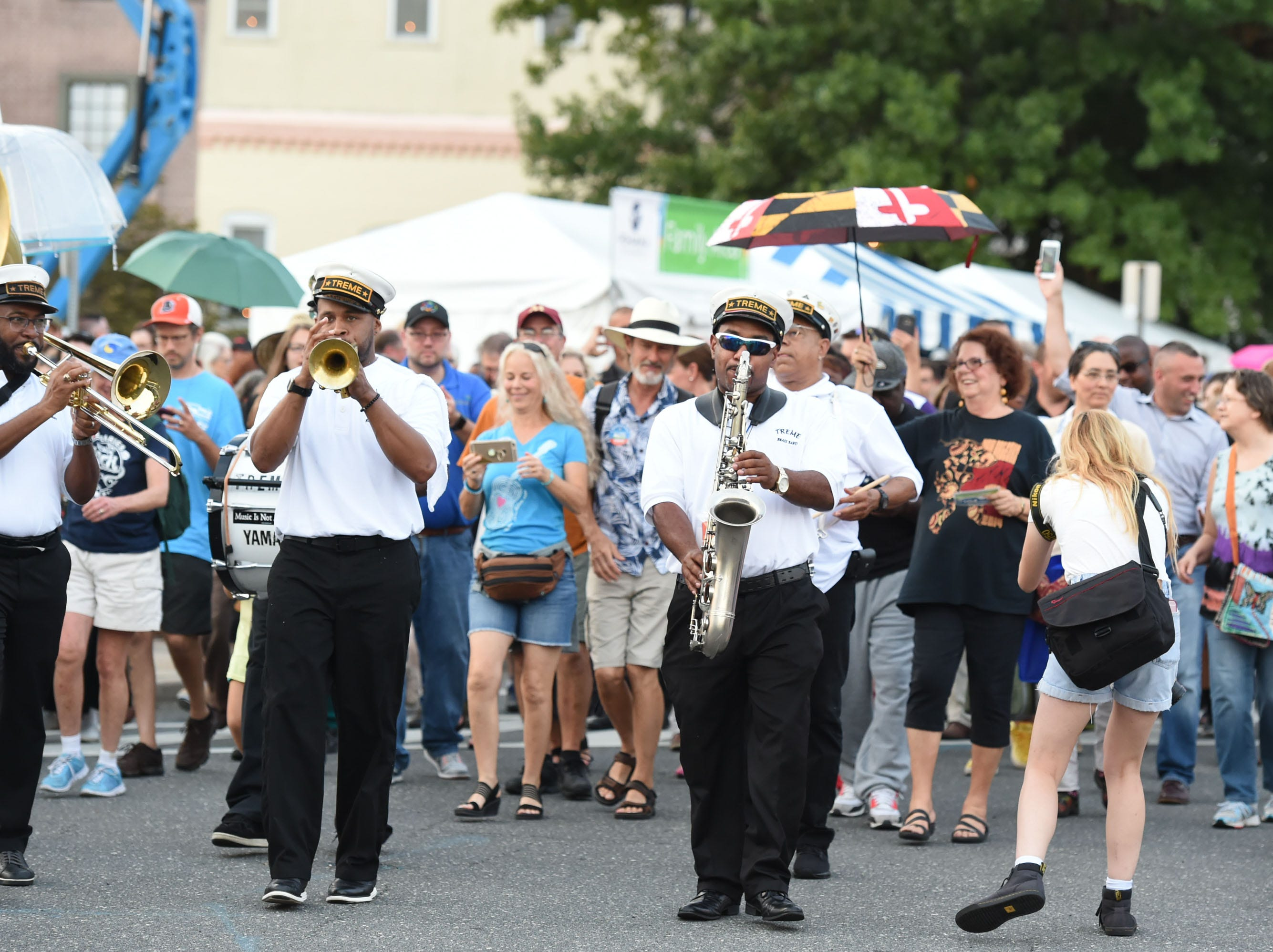 The Treme Brass Band parades down South Division Street during the kick off of the 78th National Folk Festival on Friday, Sept. 7, 2018.
