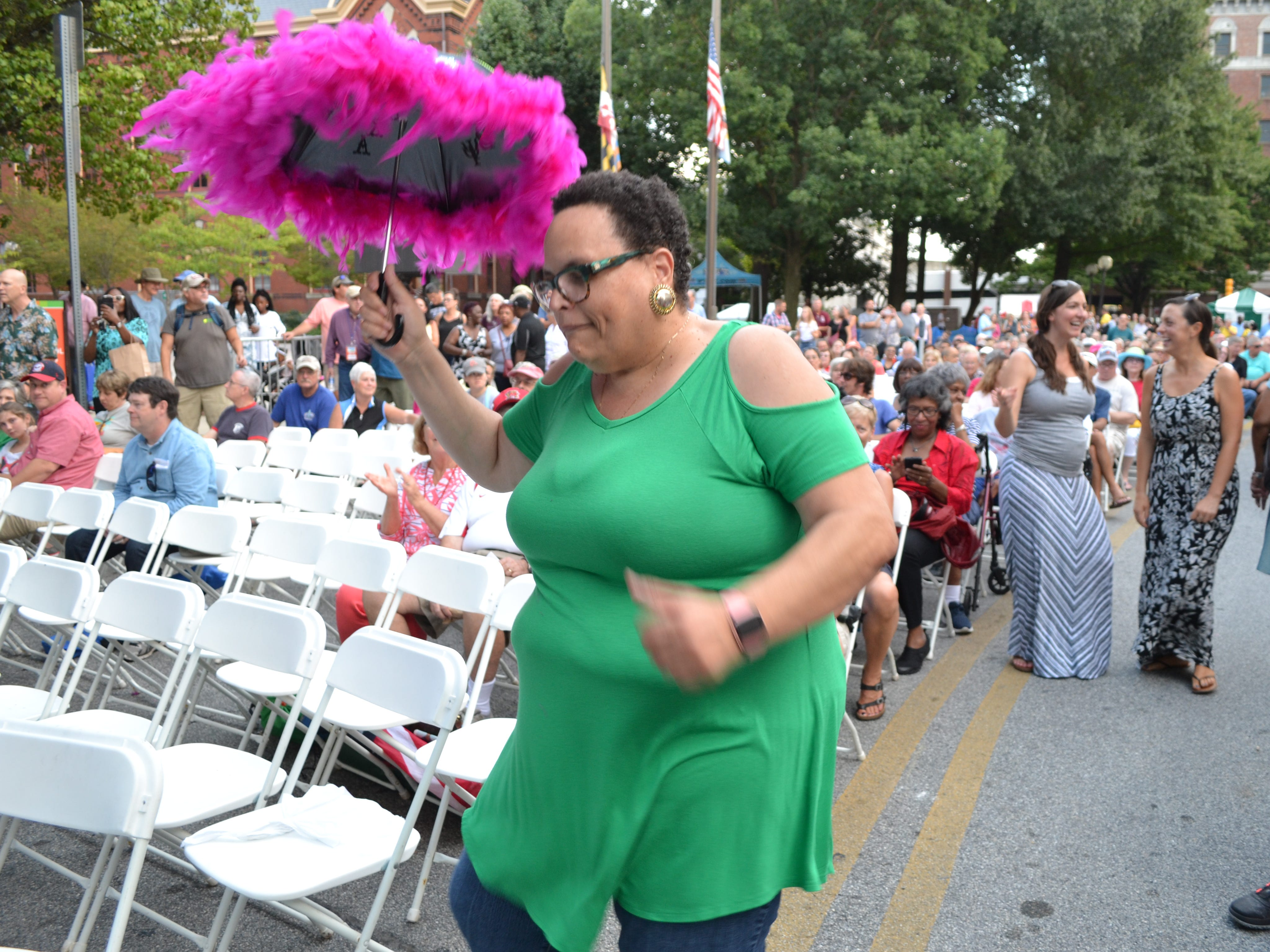 Adrienne Webber of Fruitland dances to the Treme Brass Band at the National Folk Festival in Salisbury on Friday night.