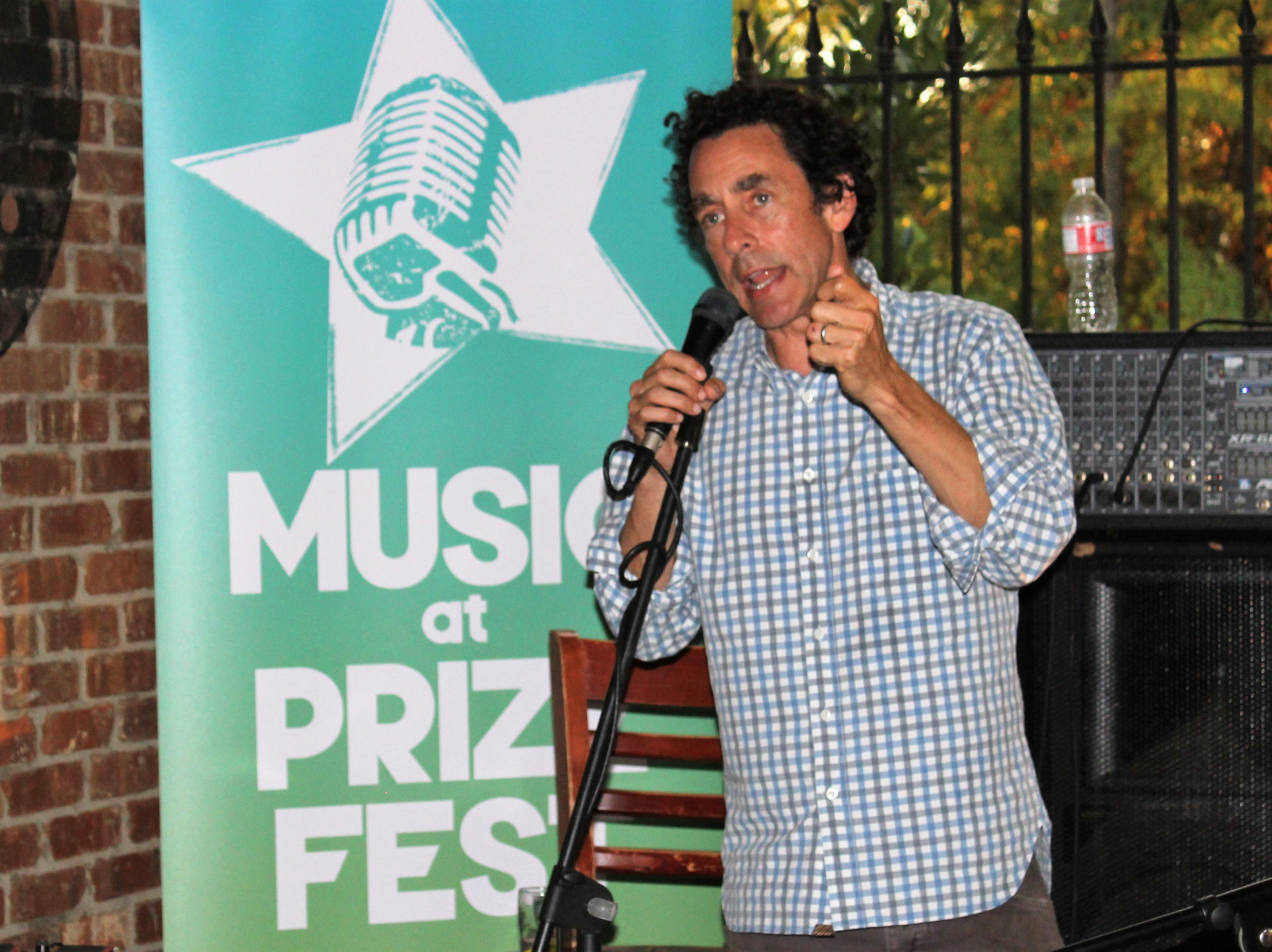 Gregory Kallenberg welcomes the crowd at Louisiana Music Prize Top 5 Announcement Party at Twisted Root Burger Co. in Shreveport.
