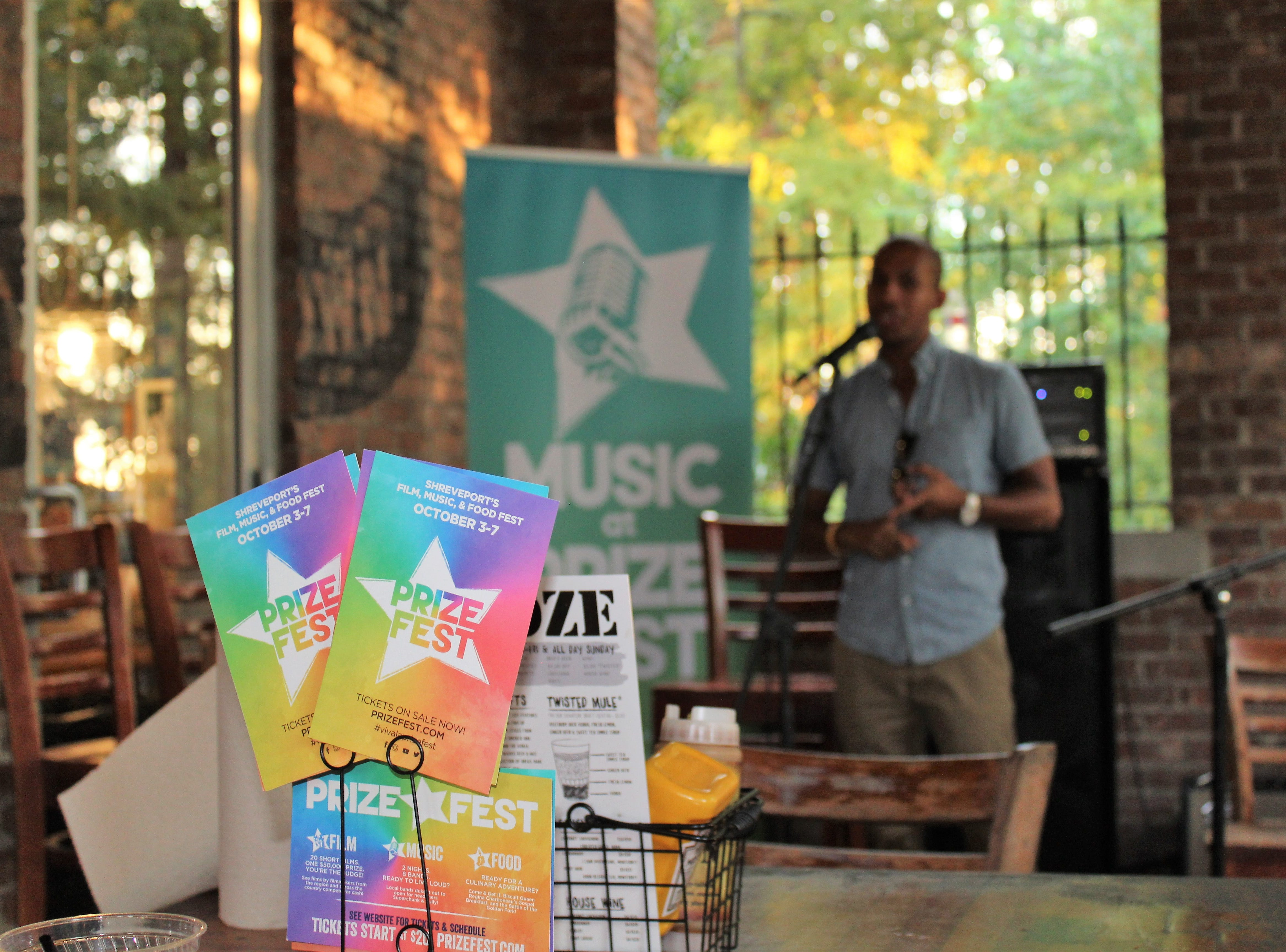 Joshua Mitchell welcomes the crowd at Louisiana Music Prize Top 5 Announcement Party at Twisted Root Burger Co. in Shreveport.