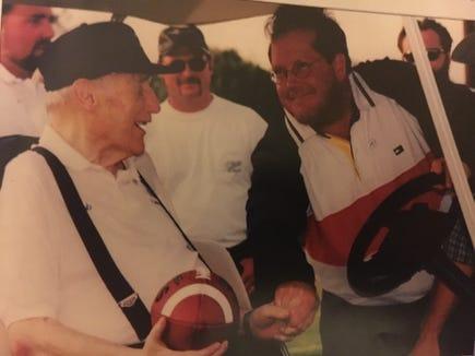 Former O'Gorman quarterback Dave Viger (right) greets Bob Burns at the 20th annual Dakota Bowl event at Howard Wood Field.