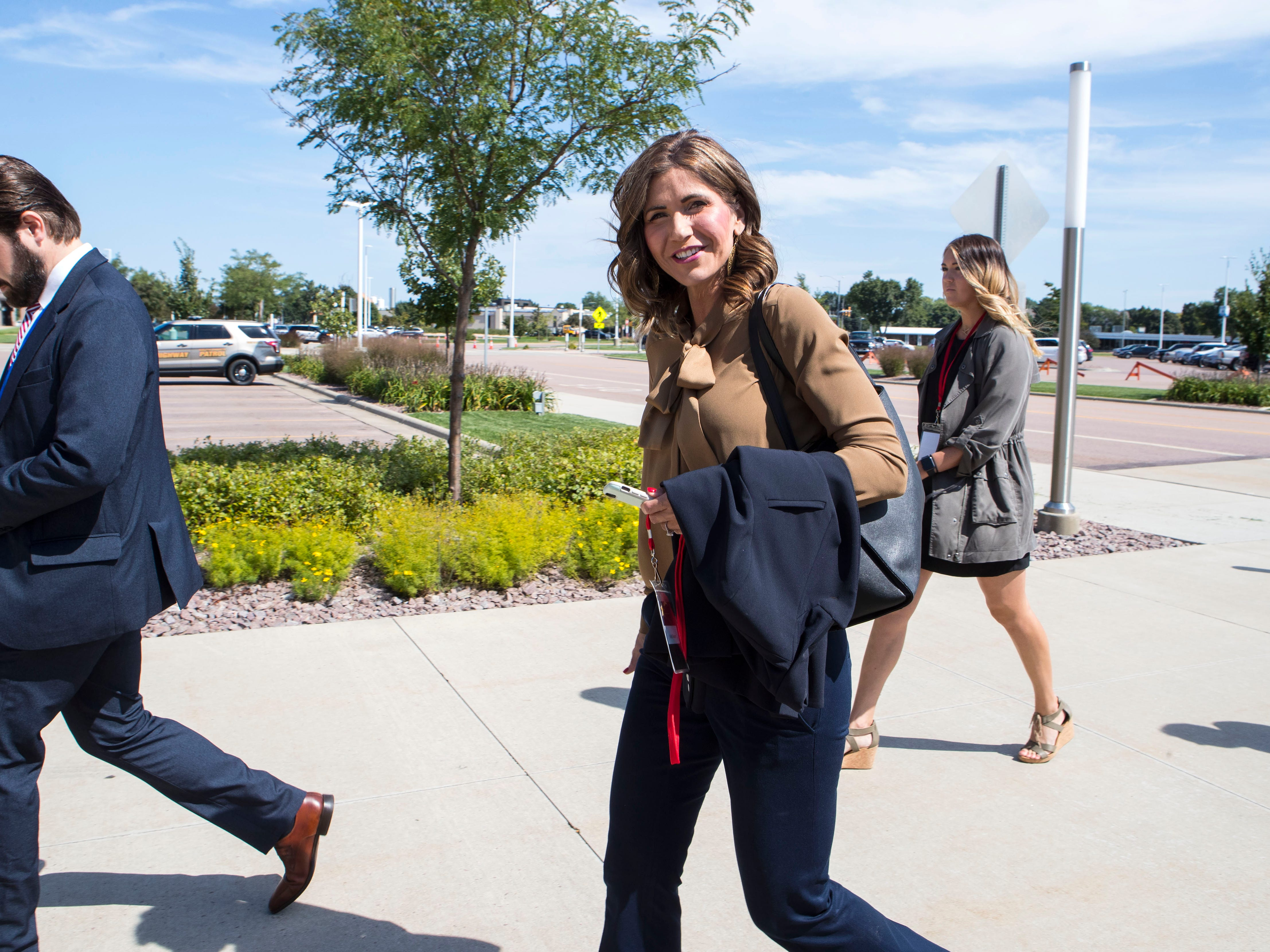 Republican gubernatorial hopeful Kristi Noem walks into the Sioux Falls Convention Center on Friday, Sept. 7, 2018 in Sioux Falls, S.D.