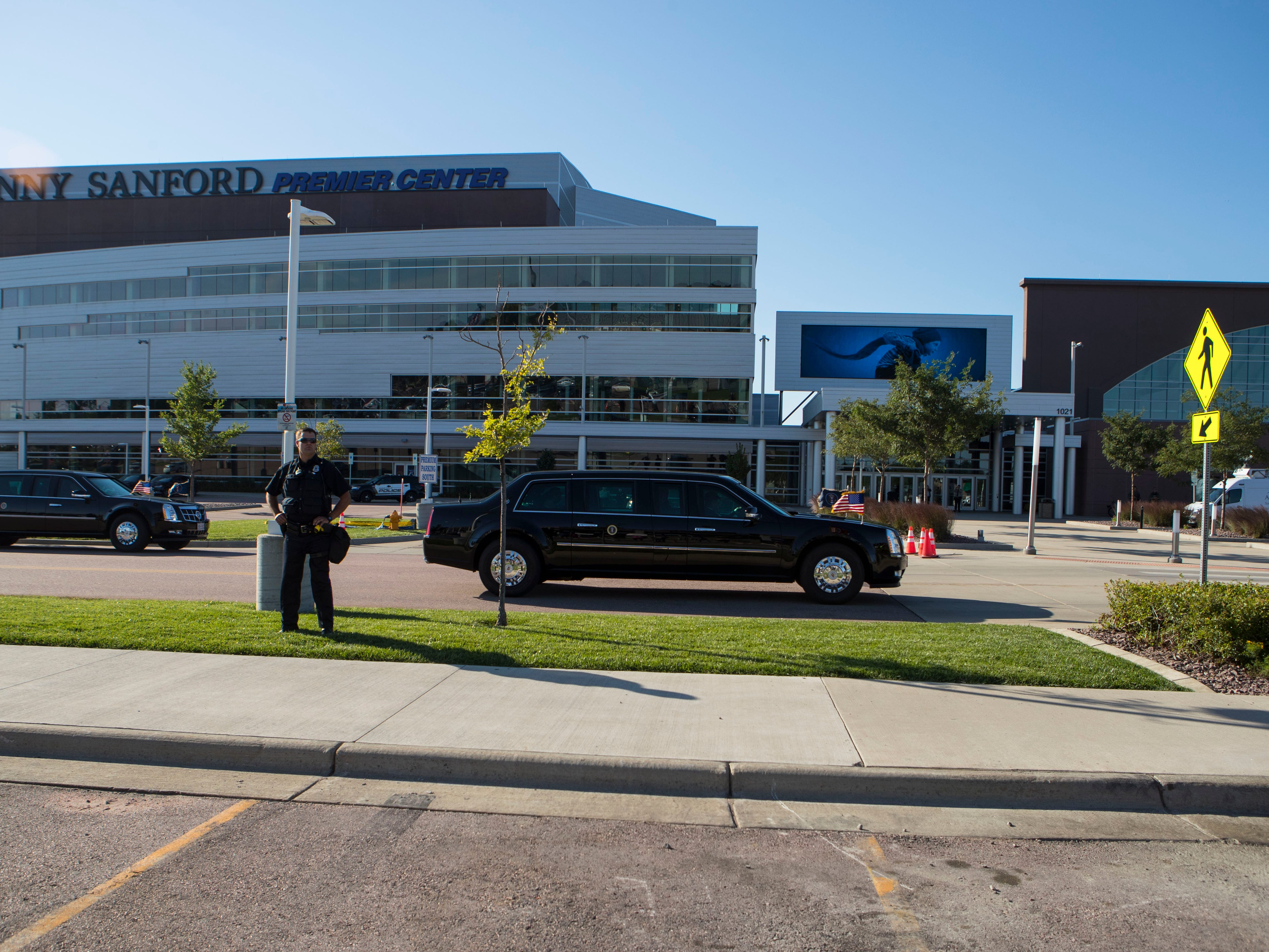 President Donald Trump's motorcade leaves the Denny Sanford Premier Center where he is attending  a closed-door fundraiser for Republican gubernatorial hopeful Kristi Noem on Friday, Sept. 7, 2018 in Sioux Falls, S.D.