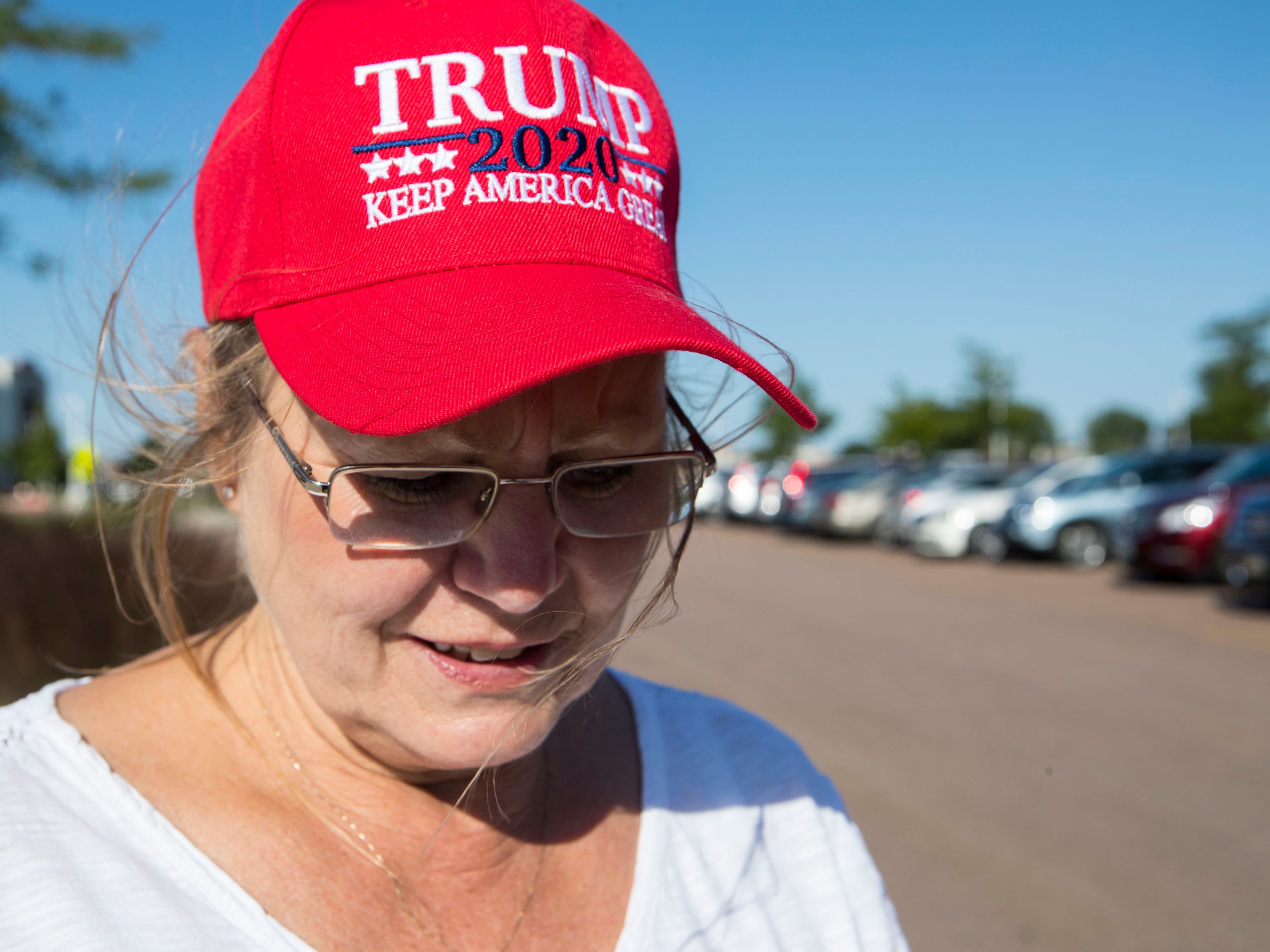 President Donald Trump supporter Nancy Scharenbroich stands outside of the Denny Sanford Premier Center hoping to get the chance to see him on Friday, Sept. 7, 2018 in Sioux Falls, S.D.