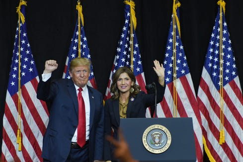 President Donald Trump and U.S. Rep. Kristi Noem speak Friday, Sept. 7, at South Dakota Air National Guard in Sioux Falls.
