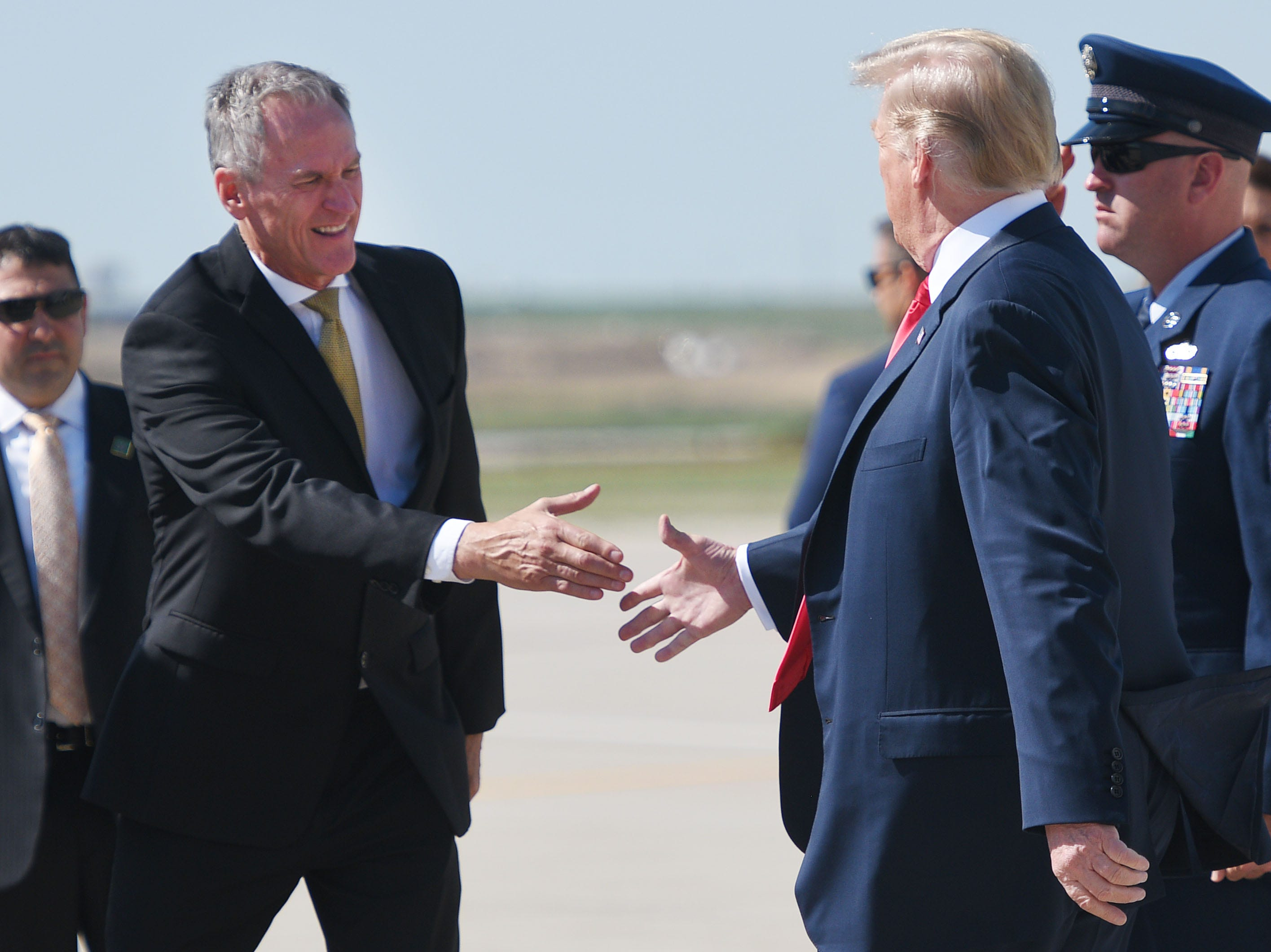 Governor of South Dakota Dennis Daugaard shakes President Donald Trump's hand as he exits Air Force One Friday, Sept. 7, at South Dakota Air National Guard in Sioux Falls.