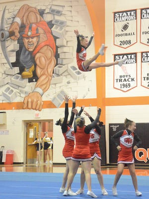 The Dell Rapids St. Mary cheer team performs at the Dell Rapids Invitational on Sept. 4.