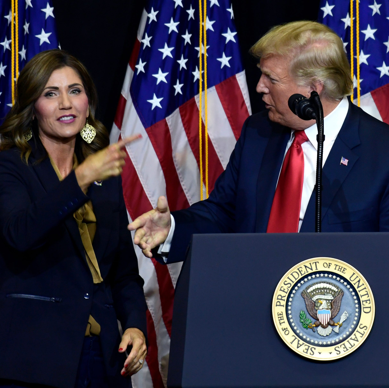 President Donald Trump speaks during a fundraiser for Republican gubernatorial hopeful Kristi Noem, left, in Sioux Falls, S.D., Friday, Sept. 7, 2018. (AP Photo/Susan Walsh)