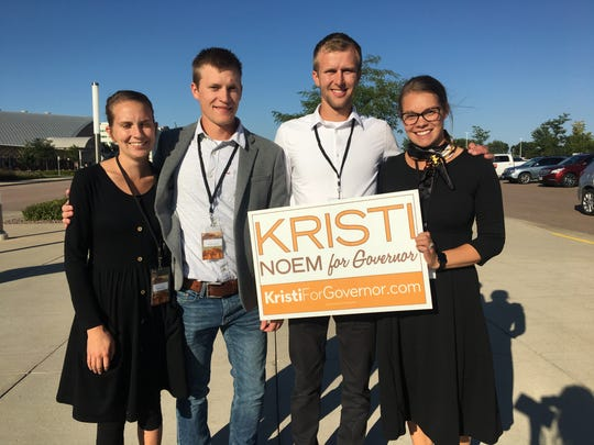 Tawni Smith, 26, Peyton Smith, 26, Dustin Kopman, 26, and Brielle Kopman, 24, attend a fundraiser event for Kristi Noem Friday, Sept. 7, 2018, in Sioux Falls. All four are Noem and Trump supporters.