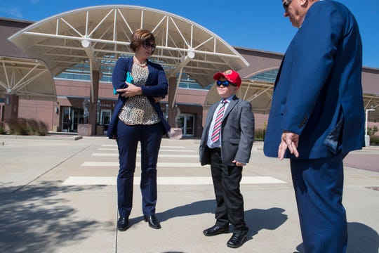 Anthony Dalsin, 8, and his parents Mike and Julie Dalsin attend the closed-door fundraiser where President Donald Trump will be attending in support of Republican gubernatorial hopeful Kristi Noem on Friday, Sept. 7, 2018 at the Sioux Falls Convention Center in Sioux Falls, S.D.