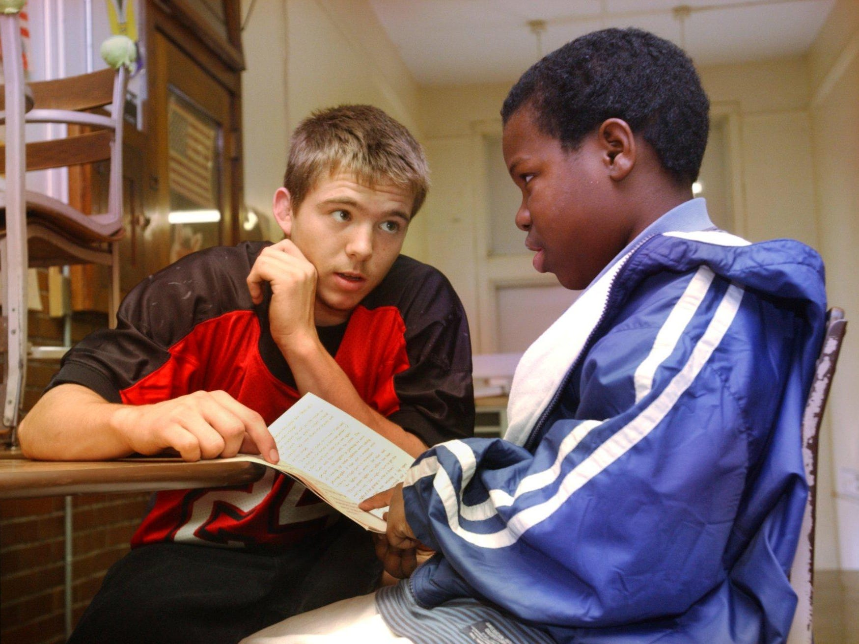 Central High School senior, Daniel Bergen, helps fourth-grader Dennis Cooper with his reading at Boyd Elementary as part of the Comer Project Philosophy program.