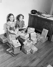 Barbara Boots, left, and Joyce Marie Thornton, right, with stacks of new books delivered for the first day of classes at the Boyd School. Published in the Leader & Press on September 10, 1951.