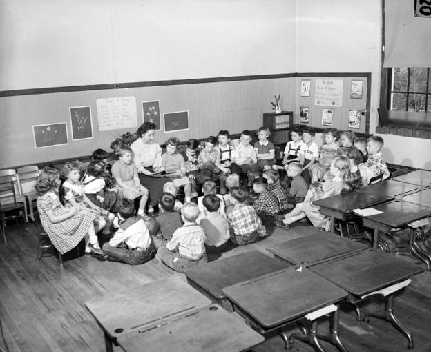 Second-graders from Boyd School listening to Bible verses. Mrs. Bernadine Hunt is seen reading to her students before the start of the day. Published in the News & Leader on April 18, 1954.