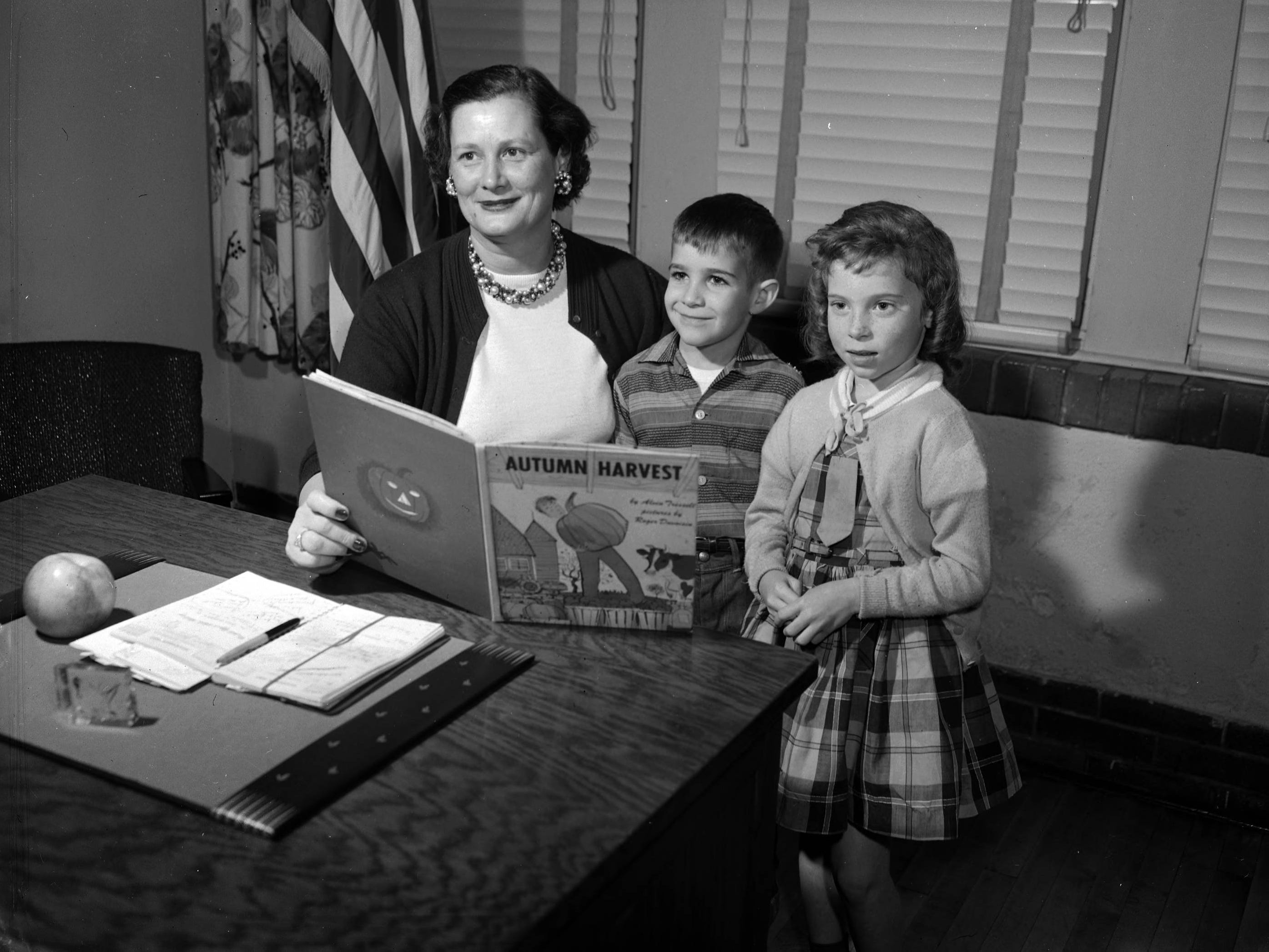 The principal at Boyd School, Virginia Renshaw, reading with two students, Terry Allen Terrill and Ruby Jean Arnold. Published in the News & Leader on November 17, 1957.