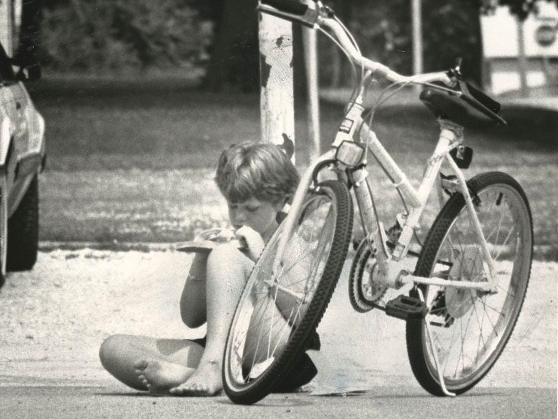Karyn Moore, 9, appears bored with summer already as she sits on the playground at Boyd Elementary School in 1991.