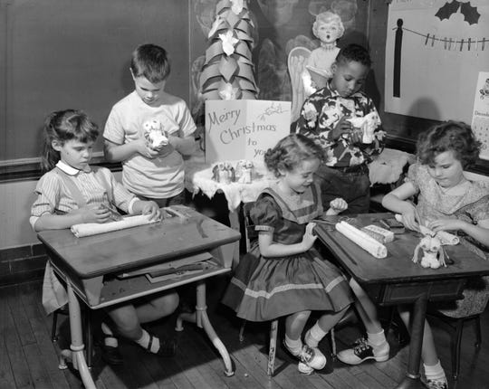 A photo from Boyd Elementary in 1956 shows students in first grade and second grade creating Christmas presents for their parents.