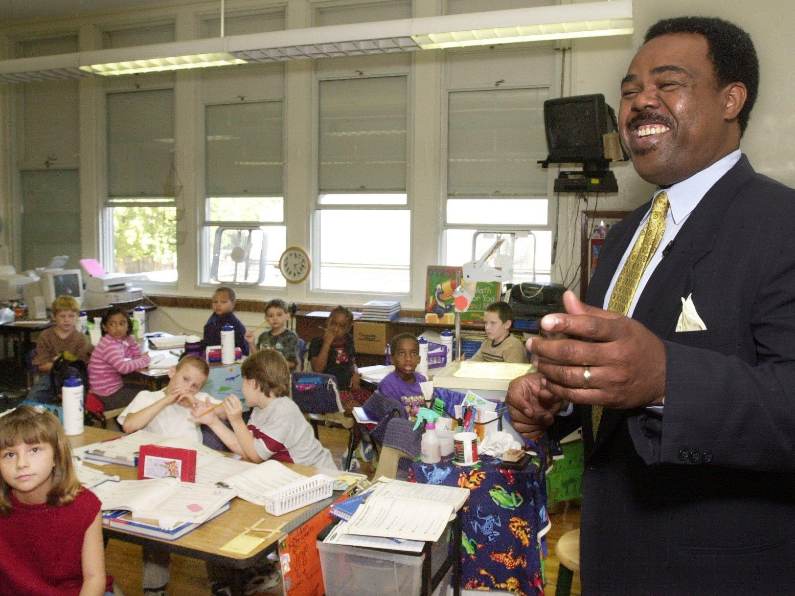 Edward Joyner, professor at Yale, and executive director of the development school program at Yale, tours one of the classrooms at Boyd Elementary.