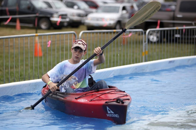 Outdoor Days visitors can try out a kayak in a shallow pool.