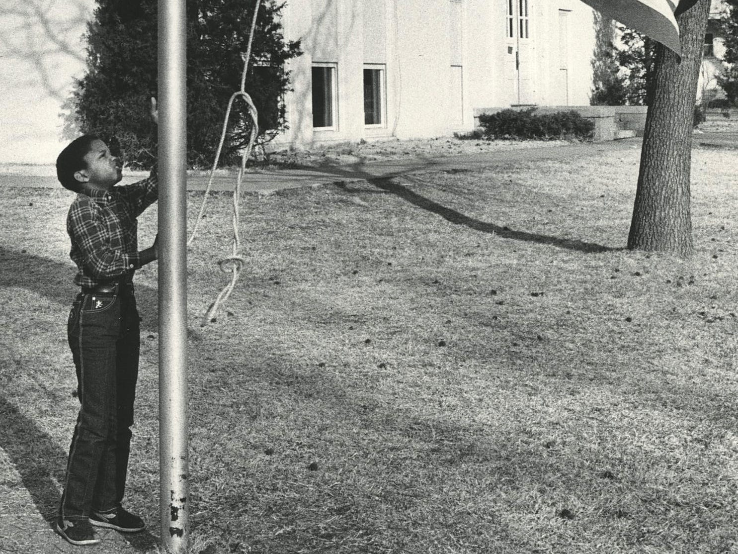 Gerry King, a third-grader at Boyd Elementary School, raises the flag to half staff in 1986.