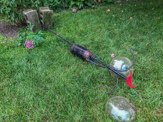 A bird feeder in the backyard of Andrea Popick in Stuarts Draft. Popick believes a bear took it down.