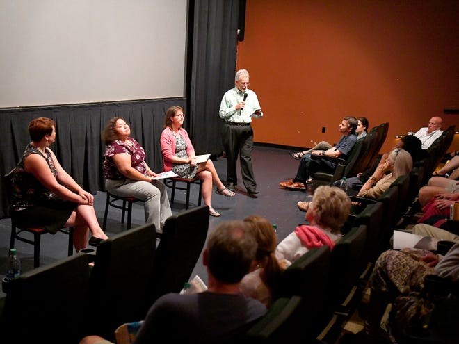 """David Fritz, executive editor with the News Leader, moderates a panel discussion and interactions with the audience after a special showing of """"The Wall,"""" part of a Pulitzer Prize winning examination of the U.S.-Mexico border region, at the Visulite in downtown Staunton on Thursday, Sept. 6, 2018."""