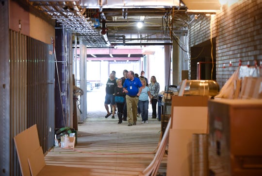 Sartell schools Superintendent Jeff Schwiebert leads a tour of the new Sartell High School under construction Thursday, Sept. 6, in Sartell.